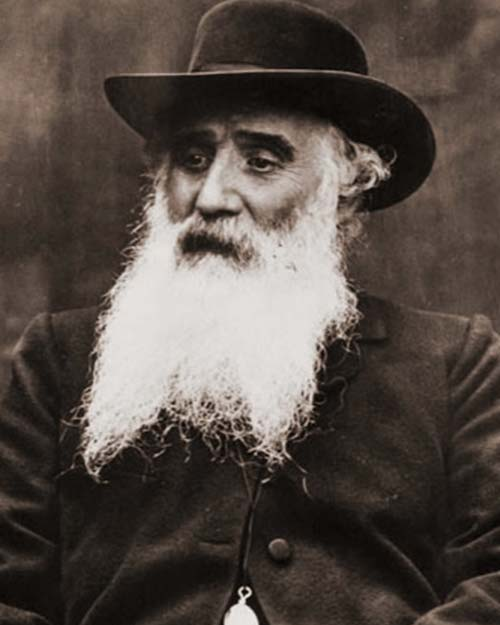 Camille Pissarro sentado